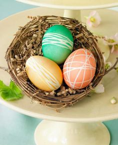 Place rubber bands around eggs before dipping in dye to create pretty linear designs.