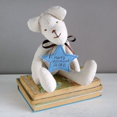 A gorgeous handmade fabric teddy bear by milly and pip - it makes a wonderful keepsake christening gift