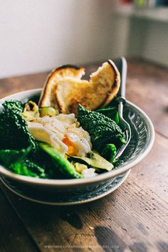 bowl of greens with poached egg and parmesan