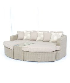 Weather-proof Resin Wicker Outdoor Sofa Daybed Set - provides a relaxing place to kick back on the porch / patio. The ottoman fits perfectly in front of the couch to make a large daybed but also looks great placed elsewhere.