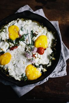 Baked eggs with feta, kale and cherry tomatoes