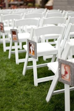 bride and groom pictures throughout the years, lined the aisles
