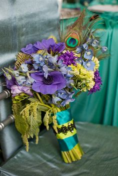 peacock bouquet. I love the bright colors..and the flowers are romantic!