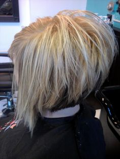 Stacked diagonal forward cut with a feather razor. Hair by Amy OBrien ...