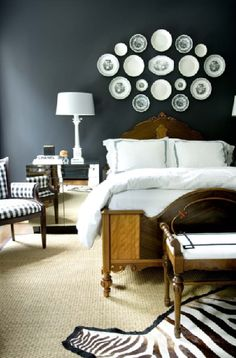 Bedding, bed, chair, lamp.
