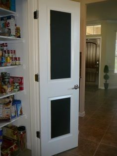 paint inside of pantry door with chalkboard paint for grocery list and kids to color on while you are cooking...