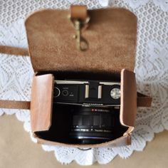 Sweet, handmade leather camera bag, found on Etsy, by Le Tresor Cache.  i actually really need one of these!