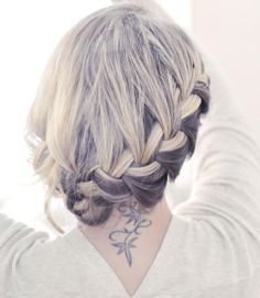 Love the hairstyle and the tattoo!