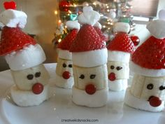 "These yummy ""Santa Party Poppers"" treats can be made using the following ingredients:  marshmallows, bananas, strawberries, mini M (red), chocolate chips (for melting), and toothpicks.  From:  Creative Kids Snacks"