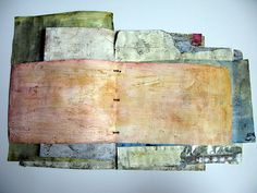 Junk Mail Book by Françoise Barnes / franswazz - pieces of junk mail covered with gesso and then watercolors in preparation for painting http://www.flickr.com/photos/romarin/with/6555054117/#photo_6555054117 #mixed_media #handmade_book #surface_treatment