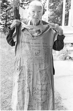 Dorothy Day with the dress she wore during her last time in jail. On November 1917 Day went to prison for being one of forty women in front of the White House protesting women's exclusion from the electorate.   (di jimforest)