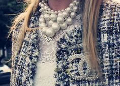 Chanel brooch and pearls.