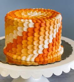 An orange ombre cake with a beautiful petal texture!
