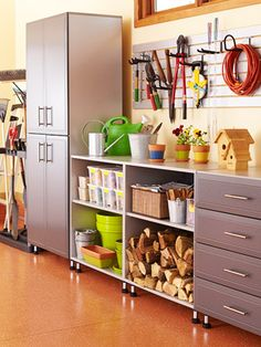 Keep the garage organized with cabinets, shelving & drawers. Can also use as a potting bench! (One of 10 diy garage storage ideas.)