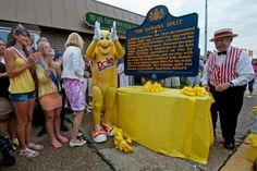 Ligonier resident Joe Greubel (right), also known as Ice Cream Joe, and others celebrate the unveiling of a historical marker on Ligonier St. in Latrobe on August 23, 2013. The marker recognizes that the first documented banana split was created in Latrobe by David Strickler in 1904. (Guy Wathen | Tribune-Review)