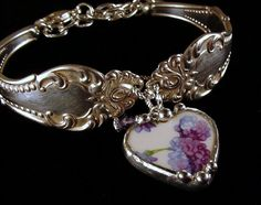 Silver spoon bracelet with broken china heart charm. Made by Laura Beth Love, Dishfunctional Designs