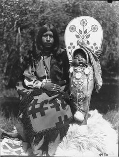 Wenatchi or Nez Perce woman known as Annie  from Wenatchee with infant in beaded cradle board,  Washington, ca. 1900-1910