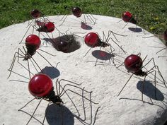 Spiders from rusted wire and light bulbs.