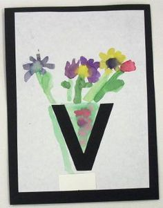 During V week, my students paint flowers in a vase. The vase is made out of a die cut V.