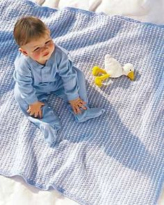 This darling baby blanket in soft shades of blue and white is just right for a little boy. Measures approximately 38 x 46 inches (96.5 x 117 cm). Shown in Bernat Softee Baby knit using size 4.5 mm (U.S. 7) and 5 mm (U.S. 8) needles.