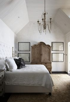 Tracery Interiors - Chic, elegant rustic bedroom with vaulted ceiling, candle chandelier, ...