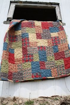 I LOVE the look of this quilt. Its made from homespuns, which I also love. Yellow brick road.