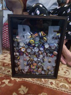 Taking an already made shadow box from Hobby Lobby, I drilled a slot out of the top and used etching cream to make the word, BEER. My brother loved it and pretty much already filled it up with some of his micro brew bottle caps.  If you are going to hang it make sure to add better supports, as this does get very heavy. He is keeping his on his bar so that wasn't a concern.  He has already requested one for all his sports and concert tickets for his birthday.