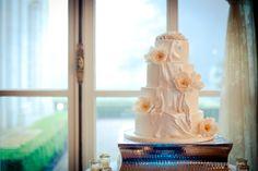 Swag and flower wedding cake, ruffle wedding cake, flower wedding cake, ivory wedding cake, classic wedding cake, modern wedding cake