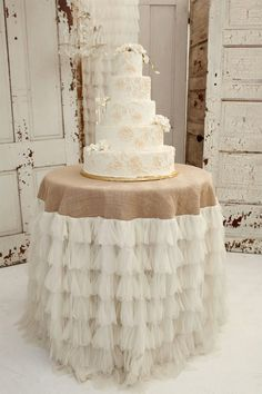 Burlap inspired table cloth with cascading ruffles for the cake table.