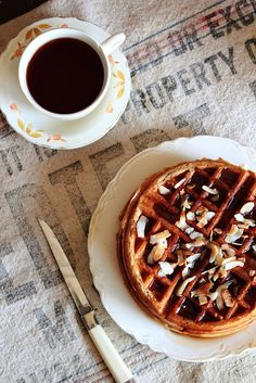 coconut waffles made with coconut milk and flaked coconut in the batter.