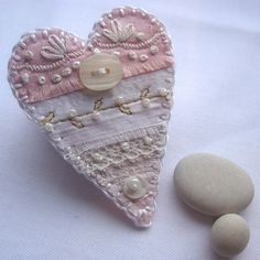 brooches, diy crafts, hands, stitch, buttons, fabric hearts, embroidery, cream, embellishments