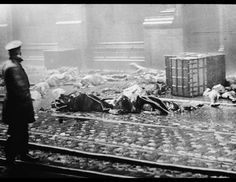 A policeman overlooks charred rubble and corpses of workers after the Triangle Shirtwaist Co. fire in New York March 25, 1911. Horrified onlookers watched 100 years ago as workers leapt to their deaths from the raging fire in the garment factory. The disaster drew attention to inadequate fire regulations and poor working conditions in the city's sweatshops. (Hulton Archive/Getty Images)