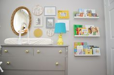 Gray gallery wall over the changing table in the nursery!