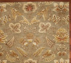 Neha floral wool rug in muted colors.