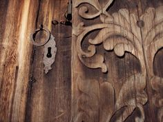 Hand-carved old barn door with beautiful hardware.
