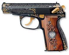 Elegant semi-automatic ladies pistol with classy wood grip. LOVE.
