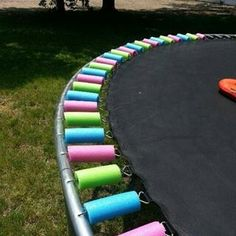 pool noodles on the springs of a trampoline. Much safer than having the springs exposed!