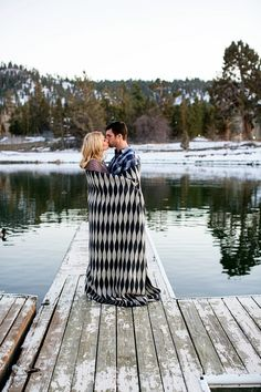 cozy photo shoot with socks and wine and blankets Big Bear Lake #winter #engagement #photos #dock
