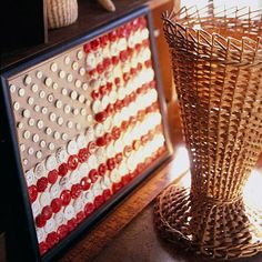 """American Flag Button Craft:  Use spare buttons to an 8 x 11"""" craft paper and glue 4x6"""" piece of blue paper in the left hand corner.  Glue 13 alternating rows of red and white buttons onto the white paper then frame (Better Homes & Gardens Idea)"""