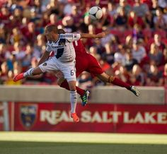 L.A.'s Bryan Jordan and RSL's Chris Wingert leap for the ball as Real Salt Lake hosts the L.A. Galaxy at Rio Tinto Stadium on Wednesday, June 20, 2012, in Sandy. (Trent Nelson  |  The Salt Lake Tribune)