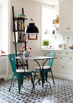 Love the chairs, table, and lamp.