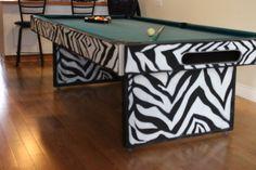 Someone went to alot of trouble to paint this this pool table like a zebra.  What do you think?