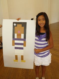A self portrait was made entirely of small square shaped pieces of colored paper.  Minecraft Inspired