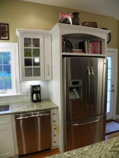 Cookbooks above Fridge! Remove cupboard doors and add some decorative wood. Great idea to use that never used/always dusty space!!!