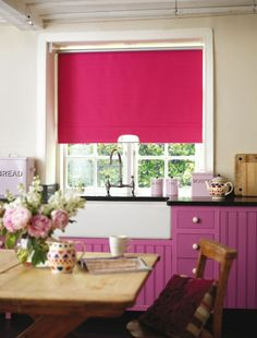 Never thought of pink in a kitchen, the blind looks good though.