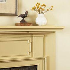 Ornate trim amplifies a mantel's warm, neutral hue. | Photo: David Prince