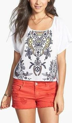 Cute top and colored shorts.