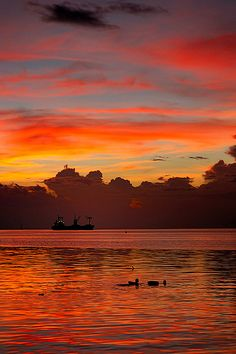 Sitting on the beach, eating pizza and watching the sun set... doesn't get any better! Manila Bay Sunset, Philippines