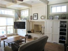 tv built-ins around fire place... do flat screen on a corner stand!