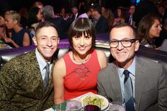 Benjamin Moore's 2014 HUE Awards: Home furnishings designer Jonathan Adler, left, and Steven Kolb, CEO, CFDA, right, congratulate fashion designer Trina Turk at the 2014 Benjamin Moore HUE Awards on Monday, Sept. 29, 2014 at the Highline Ballroom in New York. (Photo by Amy Sussman/Invision for Benjamin Moore/AP Images)